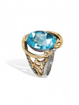 Styliano anillo de plata y oro con topacio azul