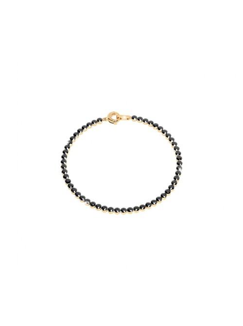 Rebecca, pulsera en plata chapada en oro con circonitas negras